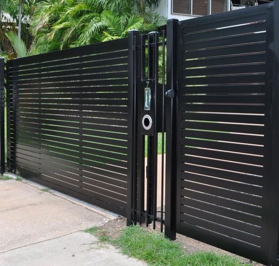 Contemporary Wrought Iron Fence  Tough-looking, sleek and ultra-modern. Clean lines, solid black paint and modern lock contraptions. This fence commands respect and attention.