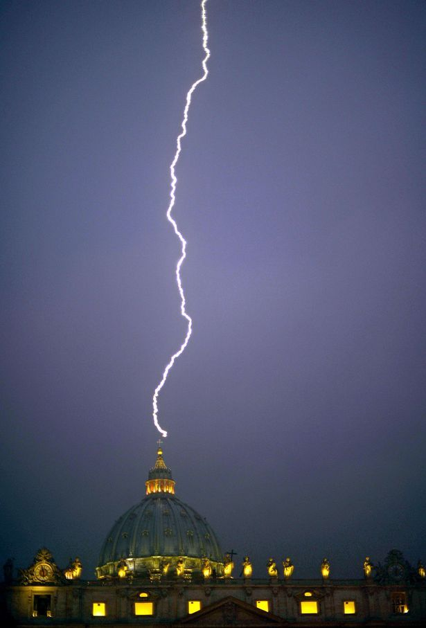 A SIGN FROM ABOVE? LIGHTNING STRIKES VATICAN HOURS AFTER POPE'S SHOCK RESIGNATION. This was the moment lightning struck the Vatican today--hours after Pope Benedict XVI's bolt-from-the-blue resignation.    The lightning touched the dome of St. Peter's Basilica, one of the holiest Catholic churches, after the Pope's shock admission he lacks strength to do the job. After all, it takes a lot of energy to suppress truth and oppress the masses.