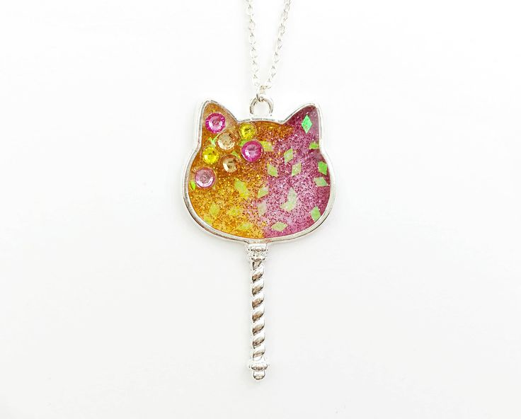 Cute cat resin necklace, now available on Etsy.