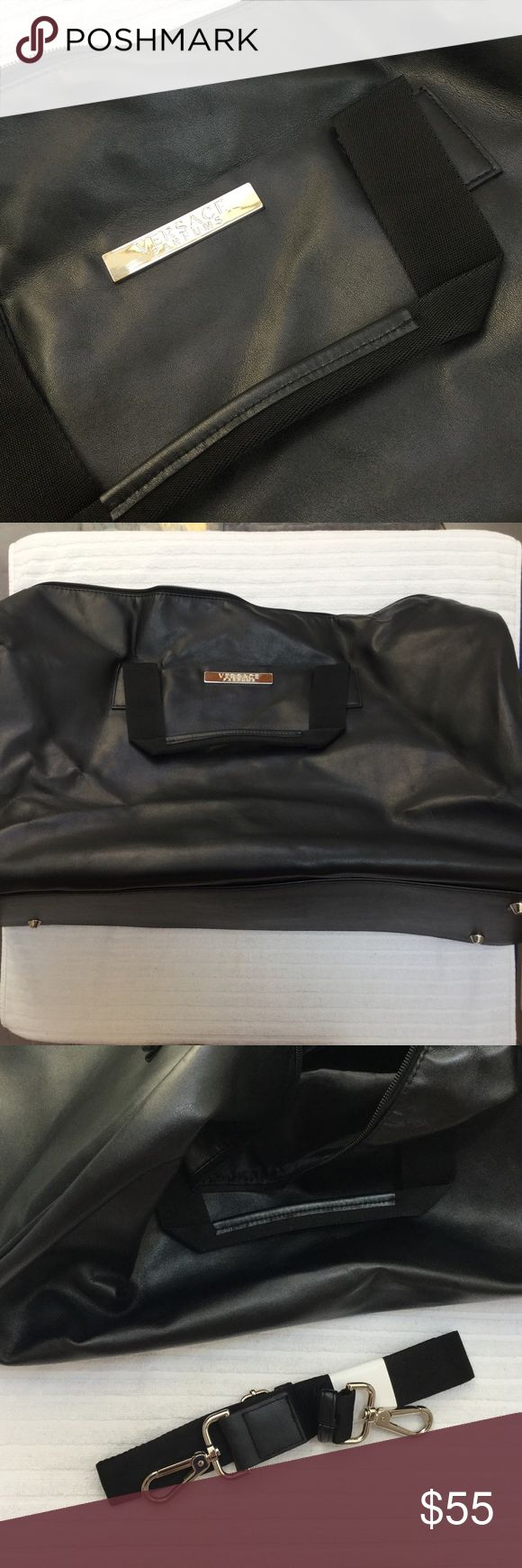 NWOT Versace Leather Duffle Genuine leather Versace duffle bag, never used. Measures 24 inches wide and 16 inches deep, the third picture shows the unopened, detachable shoulder strap. Absolutely perfect condition Versace Bags Travel Bags