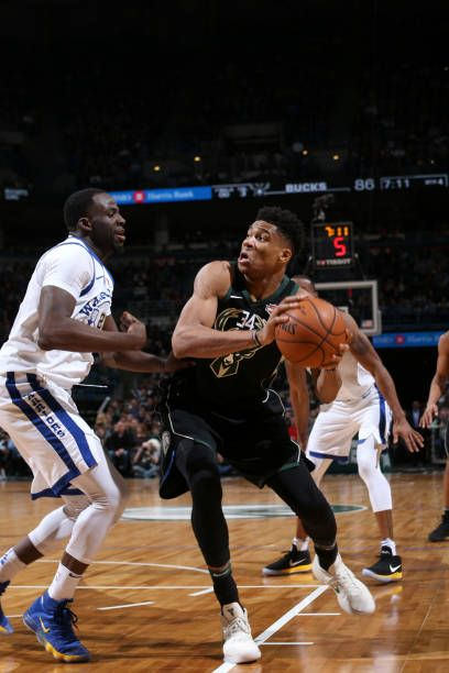 Giannis Antetokounmpo of the Milwaukee Bucks handles the ball against the Golden State Warriors on January 12 2018 at the BMO Harris Bradley Center...