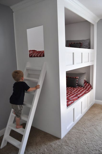 Gorgeous custom made bunk bed. Constructed out of MDF. Room curtains are a standard curtain with panels attached to bottom to extend it, in material that matches homemade comforter covers.