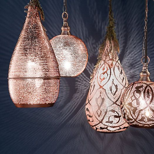 So pretty lit up- copper pendant lights.