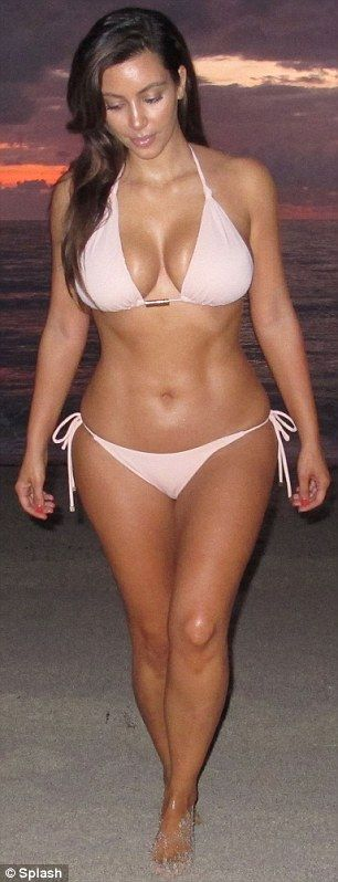 Kim Kardashian - I don't care what anyone says, she's beautiful, and has great curves!