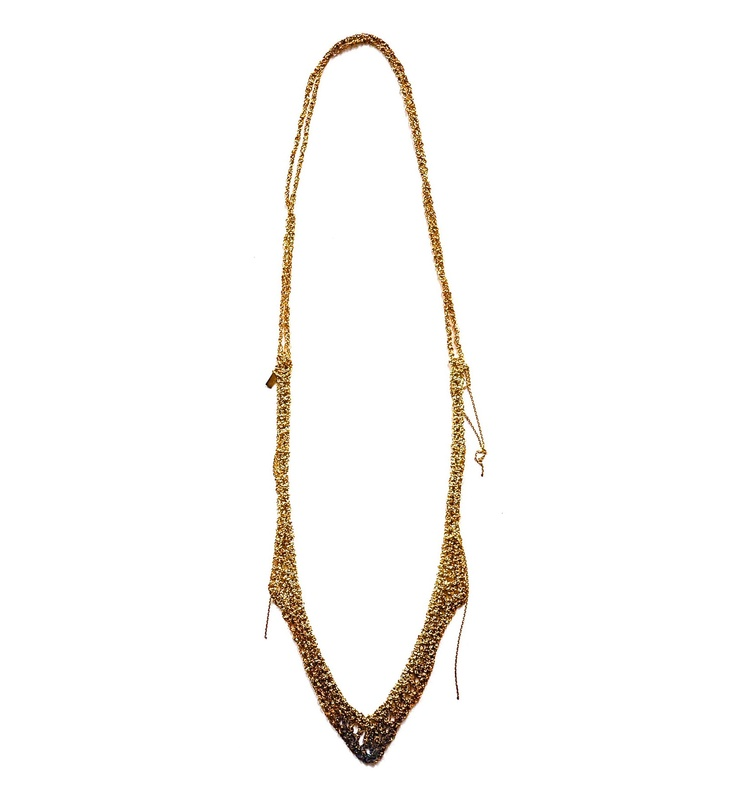 This Maripossa necklace is made from fine handwoven silver and copper oxidised chains, creating a web like effect. Available from silkstonewood.