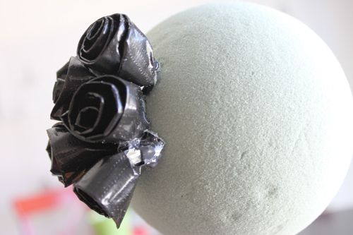 Make a halloween topiary with black duct tape!