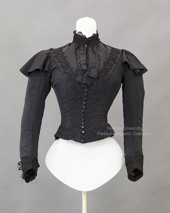 Black silk tafetta bodice, front decorative buttons inner boning, lace applique, extended shoulder ruffle, Nehru collar, lined in cotto, Petersham belt, c.1880s. FRC2013.99.029