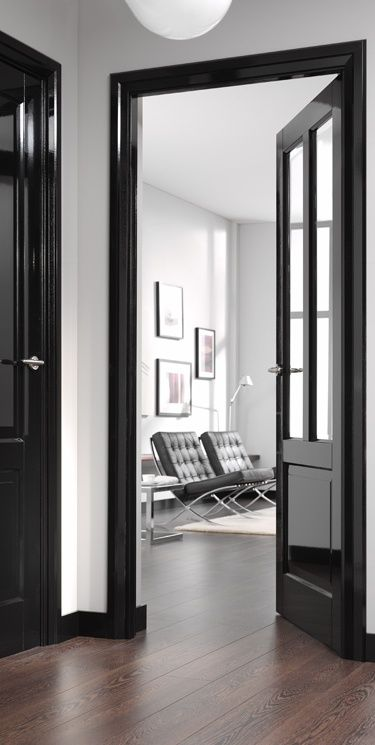 Love the statement this black door, architrave and skirting makes. http://www.threeinteriordesign.co.uk