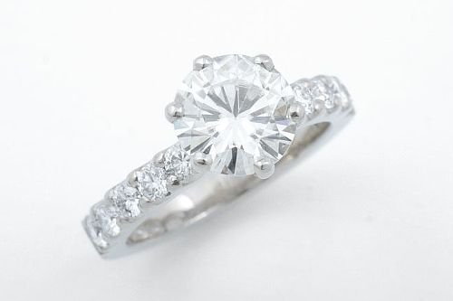 Moissanite and diamonds engagement ring. CaiSanni