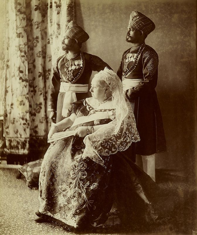 Queen Victoria with two Indian servants, Osborne House - the Isle of Wight, 1897.