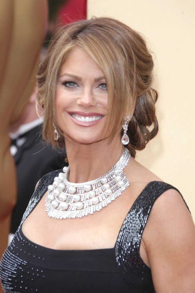 Kathy Ireland wearing an elegant updo hairstyle with bangs at the the 82nd Annual Academy Awards
