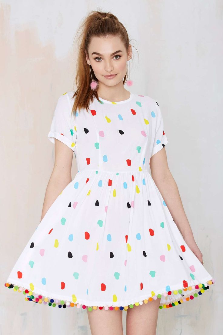 I am in love with this dress. I could see her wearing it to work because kids would love it.