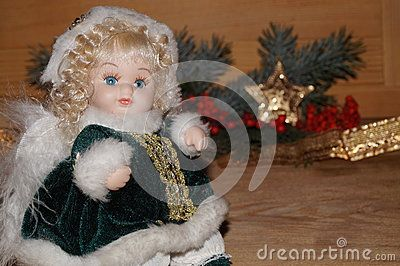 Beautiful angel on a Christmas background. The doll.