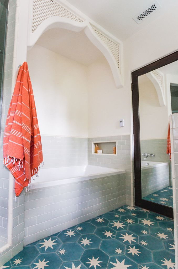 The bold Popham floor tiles in the kid's bathroom instantly transformed what was once a basic bath into a knockout of a space.