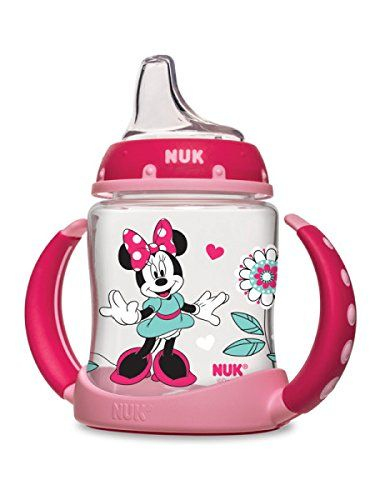 The NUK Disney Minnie Mouse Learner Cup will help your baby transition to a sippy cup in style. NUK Learner Cups are designed to help transition your baby from breast or bottle to cup easier. The spill-proof, soft spout is designed to be gentle on gums while teaching baby to drink from a spout. The removable anti-slip, easy-grip handles fit comfortably into your little ones hands and once removed, fits most cup holders! Every learner cup spout includes an air vent that helps reduce…