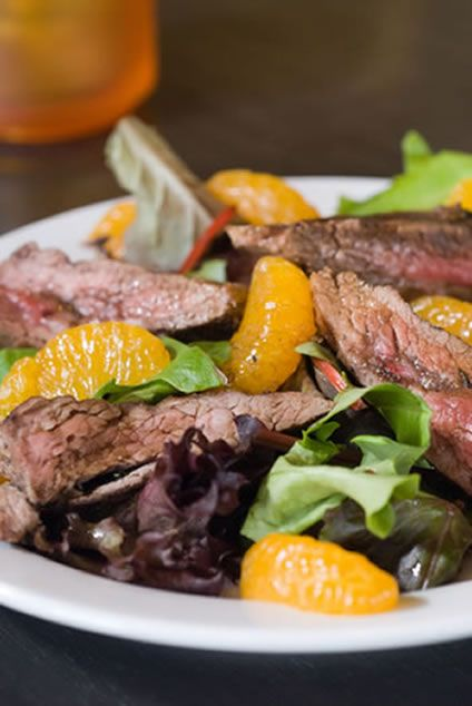 seasoned, grilled steak with salad leaves and a ginger citrus dressing ...