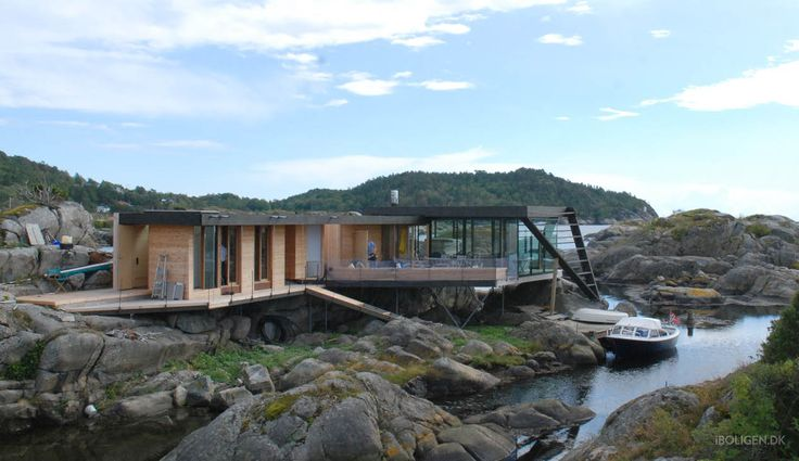 Summer house on stilts in a rough landscape of rocks.
