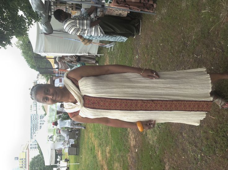 SISTER LOOKING REGAL IN ONE OF OUR ETHIOPIAN DRESSES.