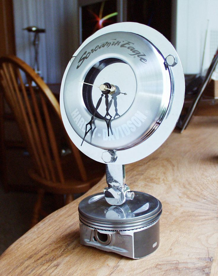 Artwork:Piston Clock by artist PreviArt - Made from Harley Davidson Recycled Motorcycle Parts.