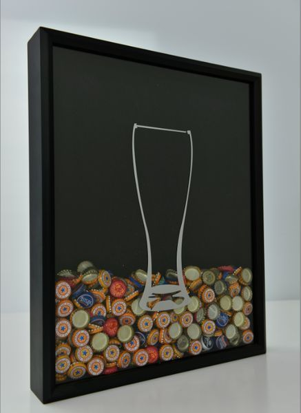 Beer Cap Collector Shadow Box. I've seen this with wine corks, I never would have thought of beer caps!