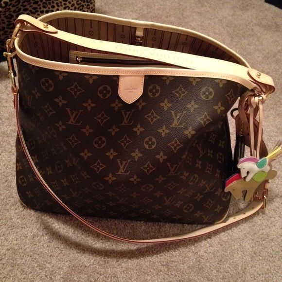 Louis Vuitton Delightful MM SD4113 Bought it from the LV in Las Vegas Fashion Show Mall back in December 2013. It's been used so it has a beautiful patina. Bag doesn't include the 2 horse charms and extra strap. Price as is for now on PM unless different payment like ️️. Not in a hurry to sell. Please be serious about it NO TRADES unless you have a Givenchy Antigona in smooth black .........Excellent condition, super clean. DATE CODE IS SD4113 Louis Vuitton Bags Hobos