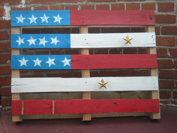 DIY-Concept American flag pallet. Will be used as a wall fixture to hang aprons in a store.  Sherwin Williams paint: Hyper Blue, Real Red, Extra White-acrylic.  Hand made star stencil.  Re-purposed--(gold stars) napkin holders screwed into the  wood.  Clothespins nailed on bottom.  Took about 4 hours to complete.