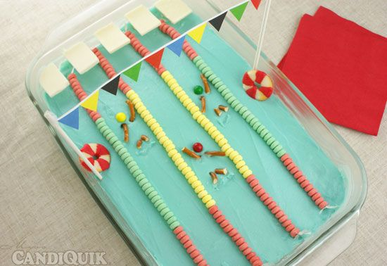 How fun is this Olympic swimming pool cake at Candiquik for your opening ceremony watching party?