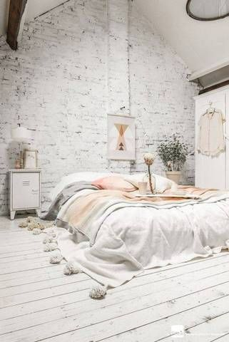 A minimalist, bohemian-esque bedroom.