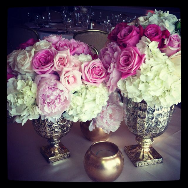 gorgeous centerpiece floral design: silver trophy urn style vases with pink peonies, white hydrangea, ivory, blush pink and hot pink roses