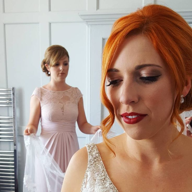 One of our lovely brides and her chief bridesmaids http://weddinghairandmakeupartists.com/