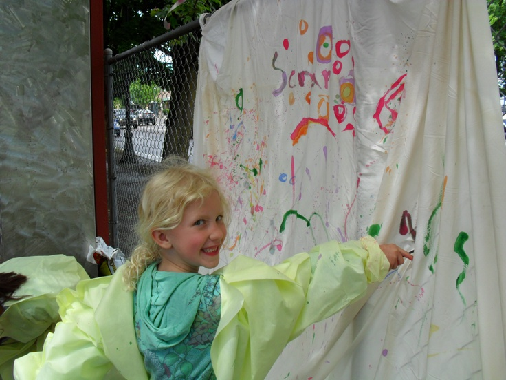 Leftover paint? We had some and felt bad washing down the sink. We tied on hospital gown covers (unused by the hospital but reused by us), watered down the paint a bit, and lit the kids have a go on a sheet tied to our fence. When it was full of color, we sewed it into curtains for SCRAP's art gallery for the annual Kid's Art Show.Art Show