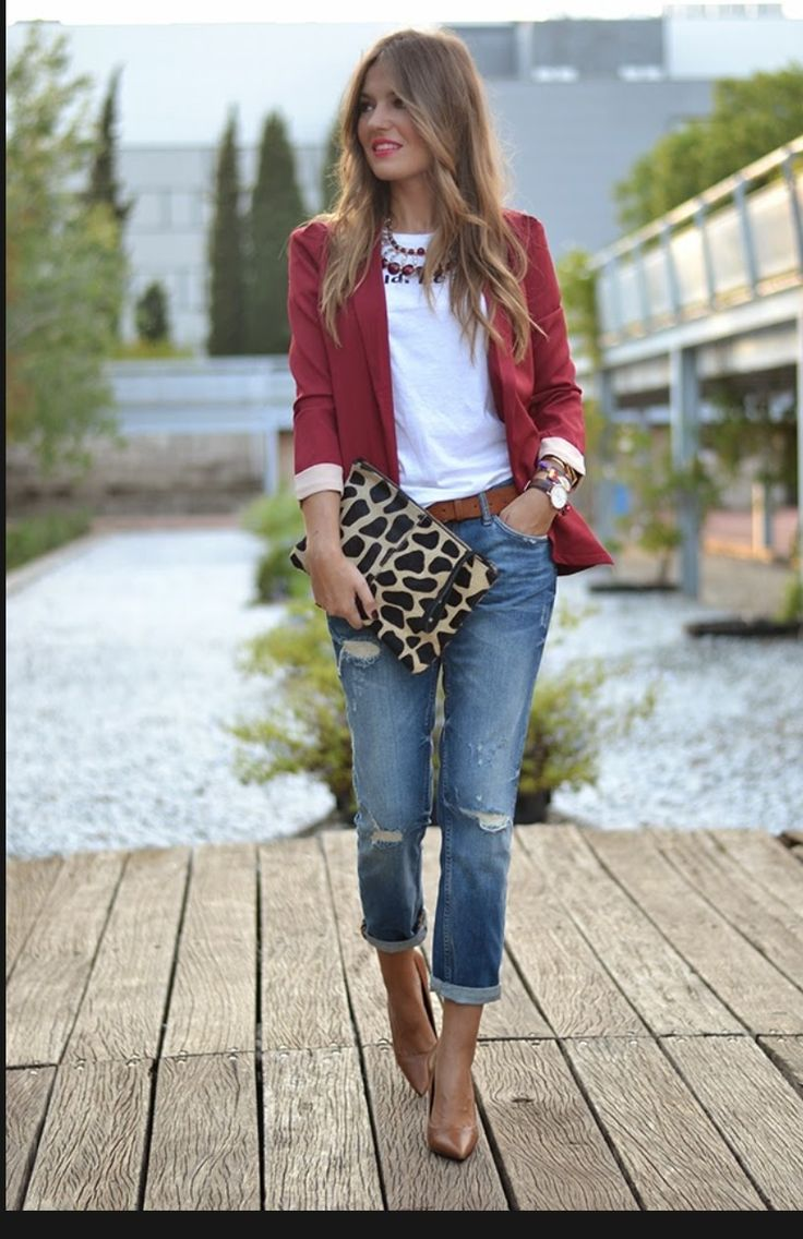 Stylish outfit with maroon blazer, white shirt, jeans, and a brown purse. Good for work, church, or going out.