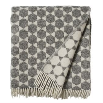 Anna-Lisa blanket or throw from Brita Sweden is made of 100 % lambs wool and it comes with a graphic design that is inspired from Brita Swedens rugs.