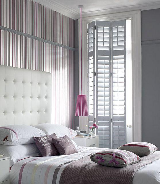 Elegant floor to ceiling shutters.