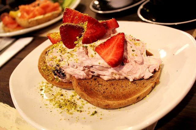fruit + nut bagels topped with berry marscapone + pistachio dust
