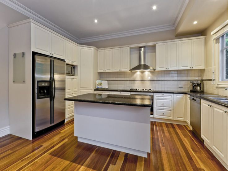 Floorboards with white kitchen cabinets