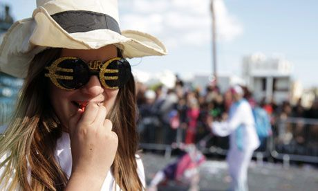 A Cypriot girl wears glasses adorned with euro signs.