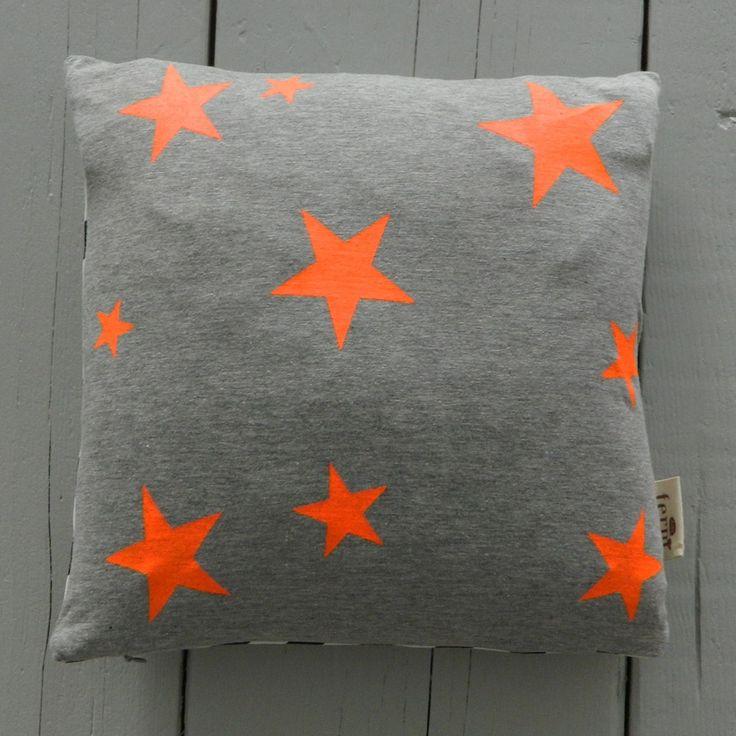 Screen printing neon stars on plain fabrics   Star Cushion Neon - Ferm Living