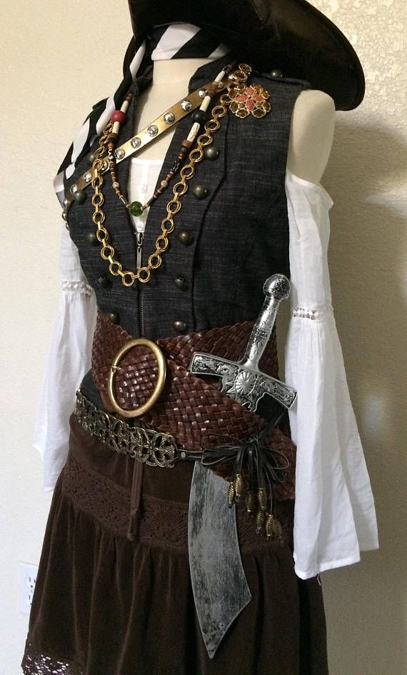 OVERNIGHT Shipping Available to most U.S. locations! Contact me with your zip code for more info.  A complete adult womens pirate costume. Size Medium Everything is included except the hat!  *Included: Brown skirt with sheer border M White sheer off shoulder chemise / blouse M Dark blue chambray vest with epaulettes and brass tone buttons M Brown leather belt with giant brass buckle M Bronze tone metal & leather stylized link belt with beads M Bronze/ Gold tone faux leather belt...