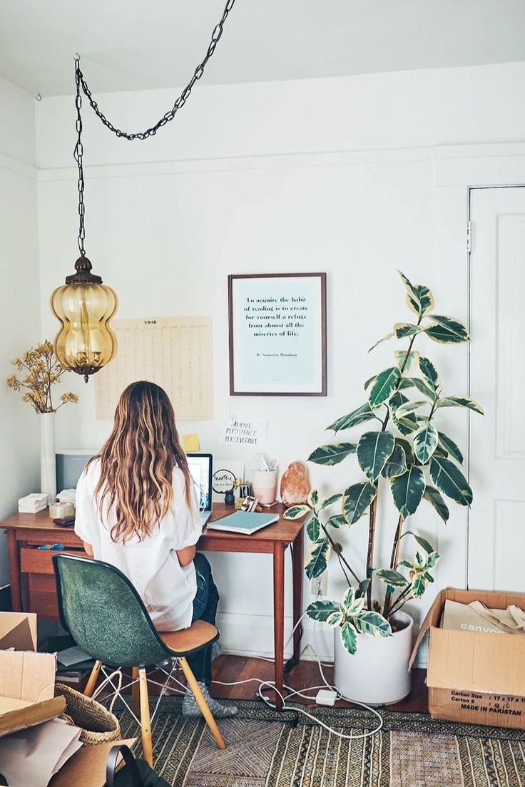 Creative Space | Desks + Foliage - Believe that is a Fiddle Leaf Tree! Antique hanging lantern + light, simple wooden desk and small business preparation