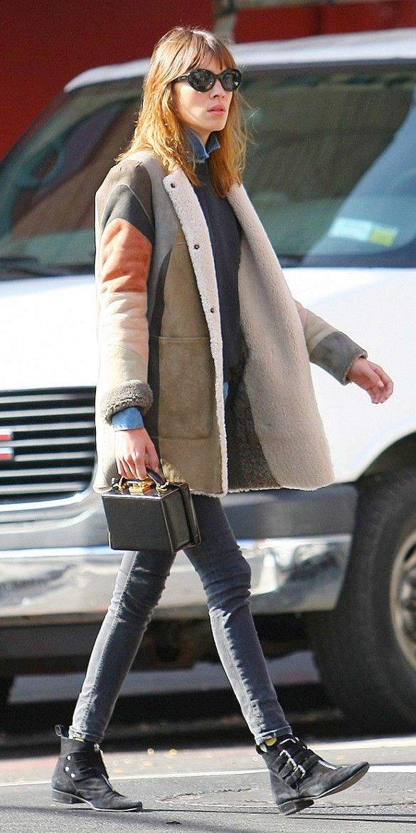Alexa Chung never fails to surprise in this effortless look wearing a patchwork coat, Tabitha Simmons early boots, and Mark Cross small grace box bag.