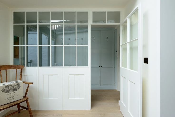 Beautiful wooden window and boot room, designed by deVOL Kitchens