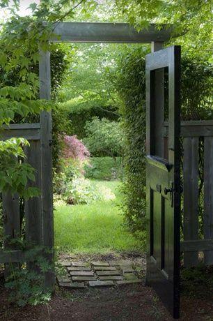 Cottage Landscape/Yard with Vintage Door, Fence, Exterior Door, Gate, Arbor, Pathway, Wood fence, Brick pathway