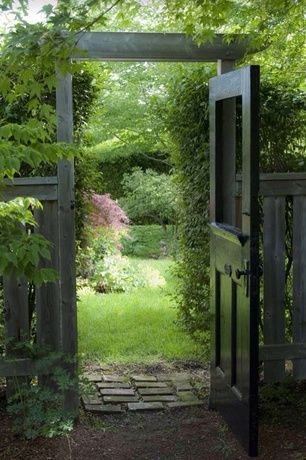 Cottage Landscape/Yard with Vintage Door, Fence, Exterior Door, Gate, Arbor, Pathway, Wood fence, Brick pathway