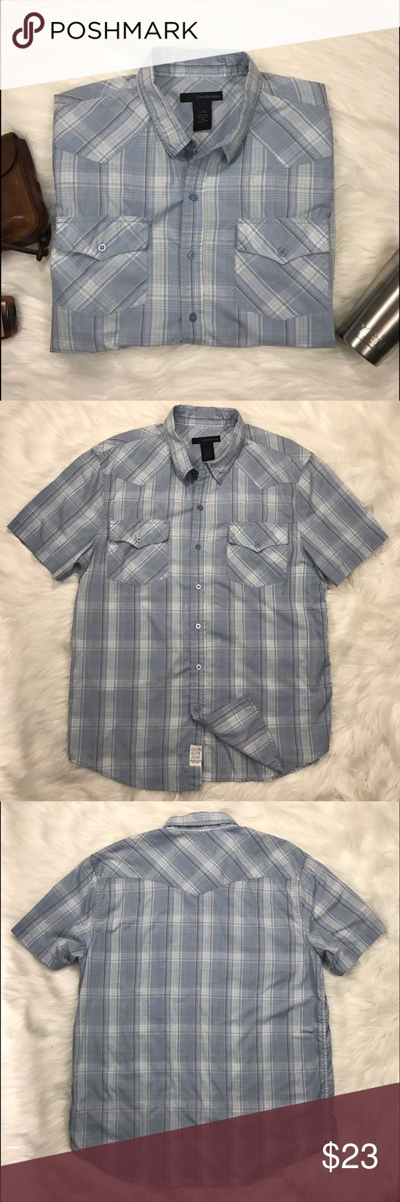 Calvin Klein - XL casual button down shirt. Calvin Klein - Men's super soft, casual plaid button downs short sleeve shirt. Look good and feel great in this shirt! Get your man out on a date night looking sharp in this shirt! Lightly pre-loved condition. Calvin Klein Jeans Shirts Casual Button Down Shirts