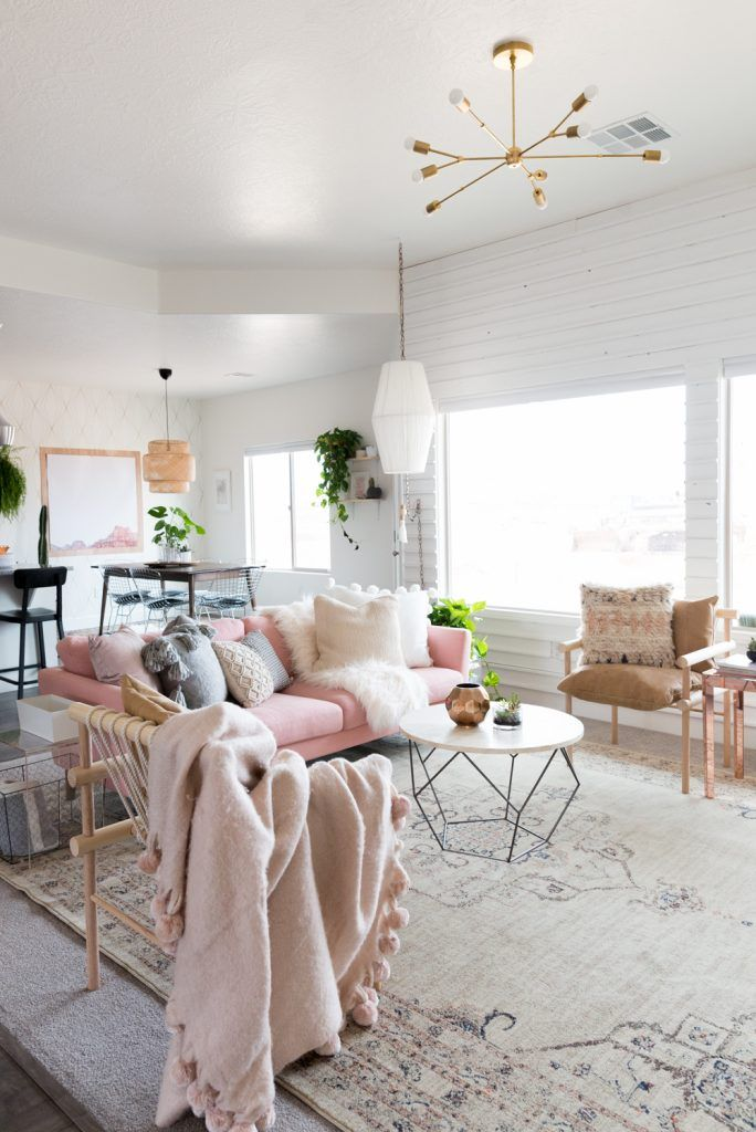 Bright living room with pink sofa