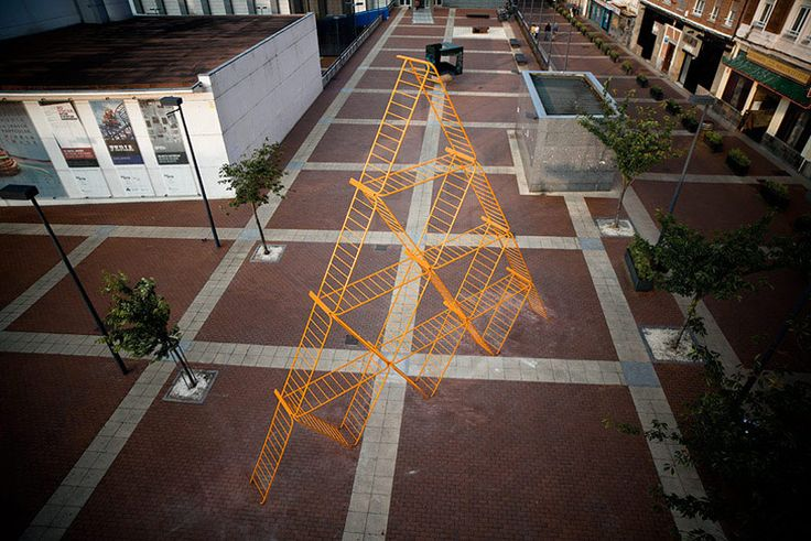 SpY urban art pyramid is constructed from safety barriers - designboom | architecture
