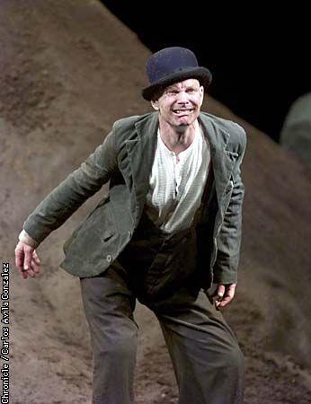With this heroic appropriation of four Samuel Beckett prose works written in 1950, the master solo performer Bill Irwin approaches the peak that great theater aspires to reach.  Irwin does it by roaming the crevasses and stony outcroppings of designer Douglas Stein's inspired set like some explorer watchful and astonished at every step he takes.  From bold rhythms and semaphoric gestures to microscopic facial tics and tiny sighs, Irwin tracks every declaration and contradiction on the page…