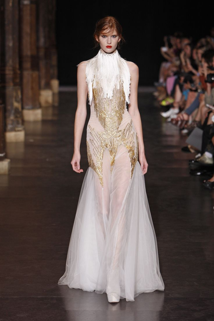 Floor length couture gown with sheer skirt