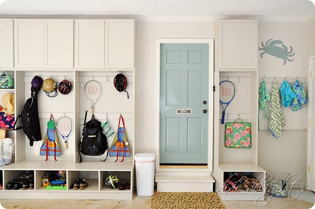 DIY garage reorganization project features white cabinetry, lockers, plenty of storage hooks and space, a place for wet and dry clothes and swimsuits, and so much more.